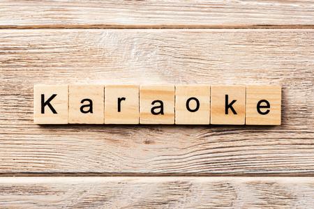 karaoke word written on wood block. karaoke text on table, concept.