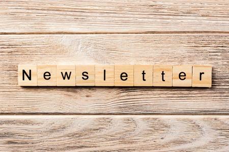 newsletter word written on wood block. newsletter text on table, concept.
