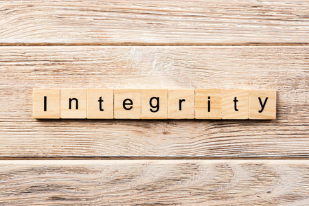 integrity word written on wood block. integrity text on table, concept.