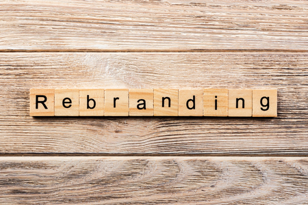 rebranding word written on wood block. rebranding text on table, concept.