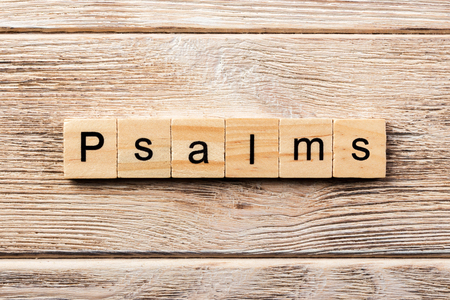 psalms word written on wood block. psalms text on table, concept. Banco de Imagens