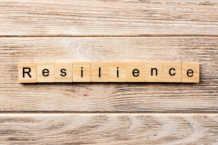 resilience word written on wood block. resilience text on table, concept.