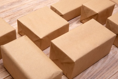 a lot of cardboard box on white wooden background. top view. Banco de Imagens
