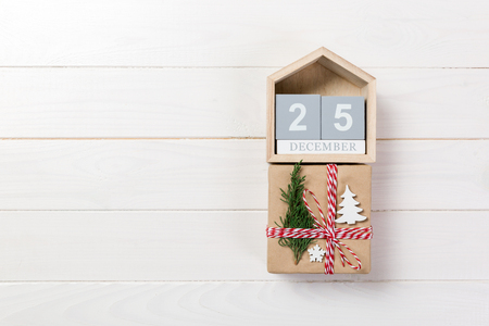 Christmas calendar 1 december. Christmas gift, fir branches on wooden white background. Copy space, top view. Zdjęcie Seryjne
