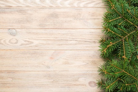 Christmas gray wooden background with fir tree and copy space. top view empty space for your design.