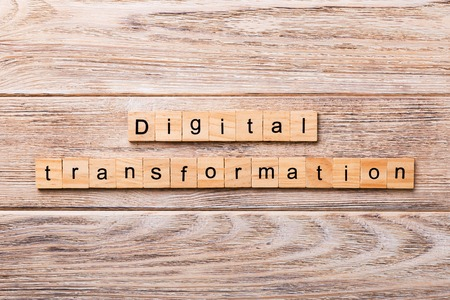 digital transformation word written on wood block. digital transformation text on wooden table for your desing, concept.