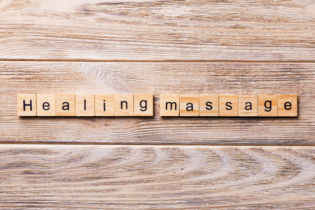 healing massage word written on wood block. healing massage text on wooden table for your desing, concept. Stock Photo