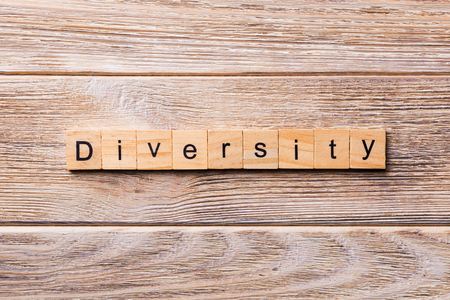 Diversity word written on wood block. Diversity text on wooden table for your desing, concept. 版權商用圖片