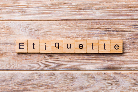 ETIQUETTE word written on wood block. ETIQUETTE text on wooden table for your desing, concept.