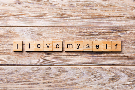 I Love myself word written on wood block. I Love myself text on wooden table for your desing, concept. Imagens - 116299772