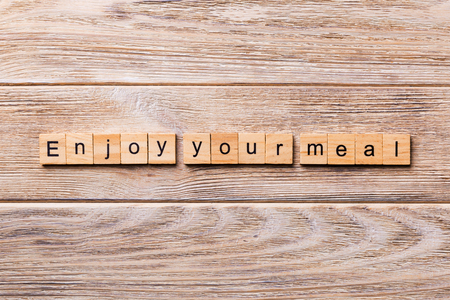 Enjoy your meal word written on wood block. Enjoy your meal text on wooden table for your desing, concept.