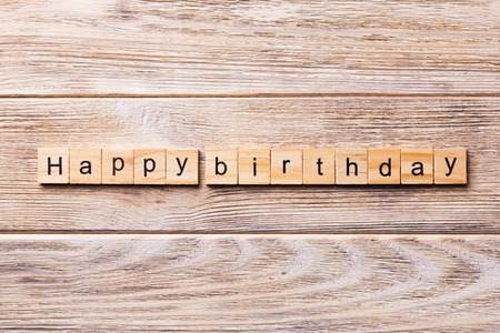 Happy Birthday word written on wood block. Happy Birthday text on wooden table for your desing, concept.