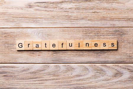gratefulness word written on wood block. gratefulness text on wooden table for your desing, concept.