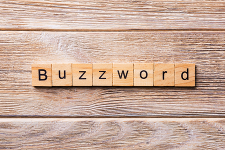BUZZWORD word written on wood block. BUZZWORD text on wooden table for your desing, concept.
