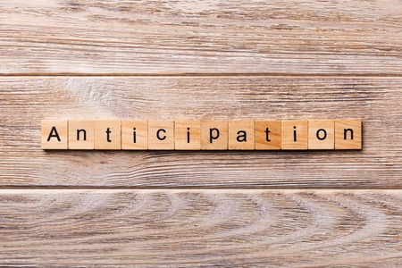 anticipation word written on wood block. anticipation text on wooden table for your desing, concept.