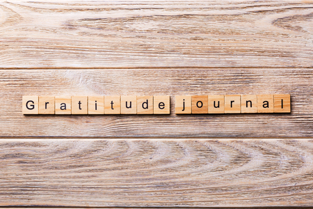 Gratitude Journal word written on wood block. Gratitude Journal text on wooden table for your desing, concept. Stock fotó