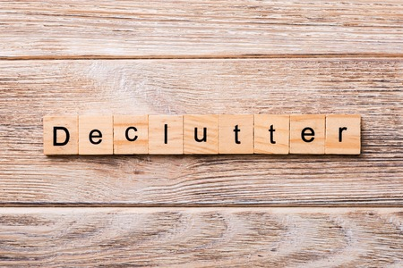 Declutter word written on wood block. Declutter text on wooden table for your desing, concept. Stock Photo
