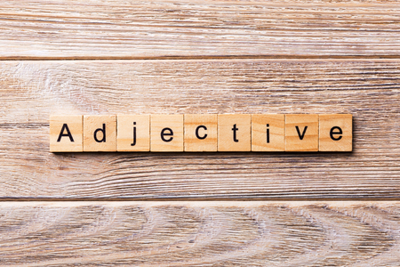adjective word written on wood block. adjective text on wooden table for your desing, concept.