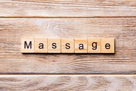 massage word written on wood block. massage text on wooden table for your desing, concept.