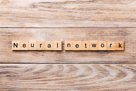 NEURAL NETWORK word written on wood block. NEURAL NETWORK text on wooden table for your desing, concept.