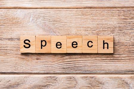 speech word written on wood block. speech text on wooden table for your desing, concept. Stock Photo
