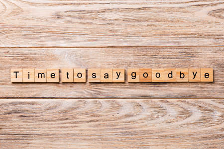 Time to say goodbye word written on wood block. Time to say goodbye text on wooden table for your desing, concept. Stockfoto