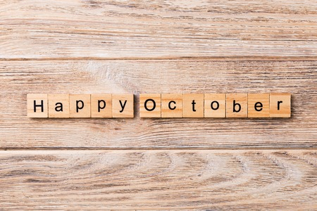 Happy october word written on wood block. Happy october text on table, concept. Stock Photo