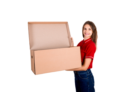 Young delivey person is holding a big opened parcel box isolated on white background.