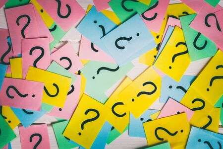 colorful paper notes with question marks. Closeup.