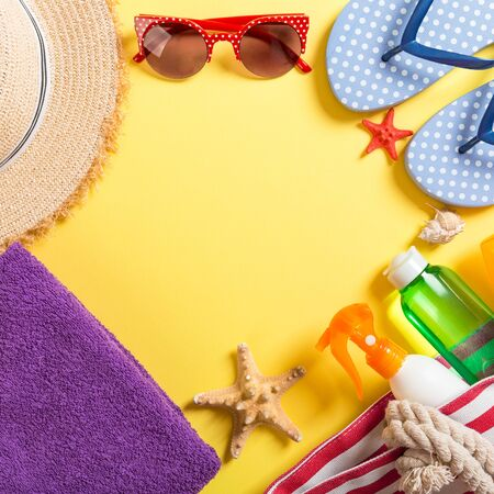 Summer vacation background with copy space. Flat lay photo on color table, travel concept. Free space for text, mock-up.