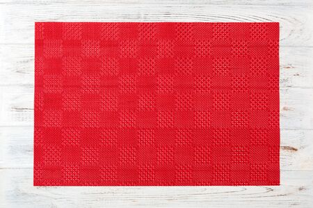 Tablecloth textile on wooden background top view with copy space.