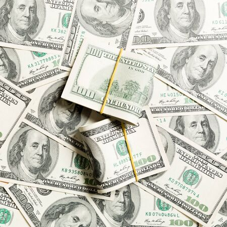 Stacks of one hundred dollars banknotes close-up on dollar background business concept top view with copy space. Stok Fotoğraf