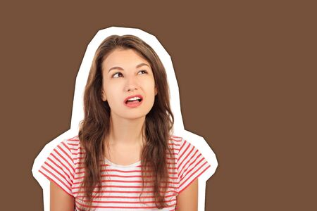 Headshot of indecisive confused young girl. emotional girl Magazine collage style with trendy color background.