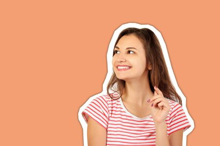 Portrait of a young charming cheerful woman playing with her hair. emotional girl Magazine collage style with trendy color background.