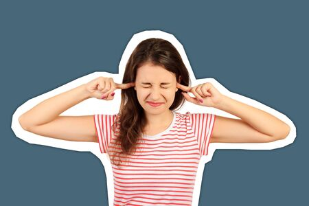 Portrait of angry stressed out young woman plugging ears with fingers and closing eyes tight. emotional girl Magazine collage style with trendy color background.