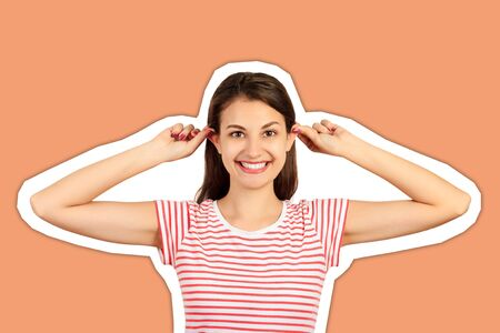 Funny-looking woman grimacing making ears protruding. emotional girl Magazine collage style with trendy color background. Stock Photo