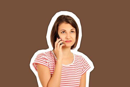 disgruntled girl talking on mobile phone. look with perplexity. emotional girl Magazine collage style with trendy color background.