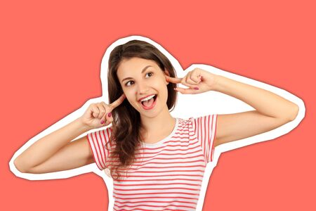 Funny goofy young woman with bug eyes grimacing, having stupid and ridiculous facial expression. emotional girl Magazine collage style with trendy color background.