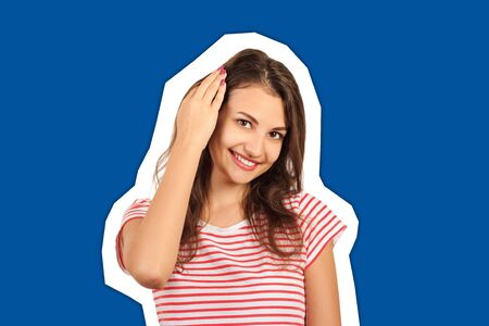 Close up picture of a young beautiful woman fixing her hair while looking at the camera. emotional girl Magazine collage style with trendy color background.