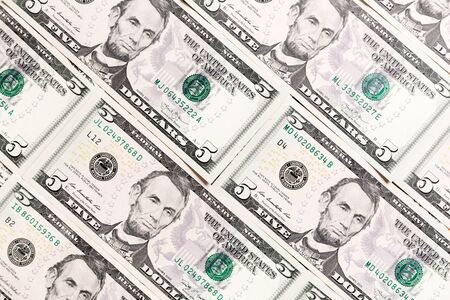 Close up of 5 dollar bills as a background. American dollars pattern. Top view of business concept.