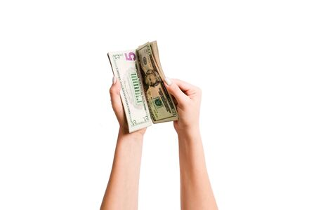 Isolated image of female hands counting dollars on white background. Top view of salary and wages concept.