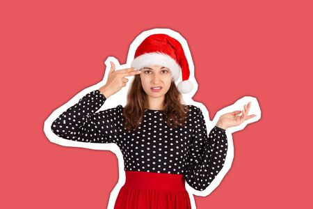 Annoyed and displeased woman in dress shrugging and holding fingers on temple. emotional girl in santa claus christmas hat Magazine collage style with trendy color background. holiday concept.