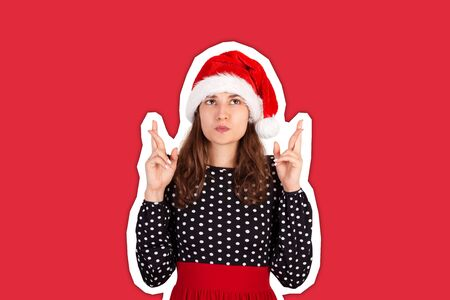 confused woman with raising hands with crossed fingers, making wish to win. Magazine collage style with trendy color background. holiday concept. Stock Photo