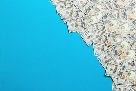 dollar bills a on a light colored background. copy space, top view business concept. Reklamní fotografie