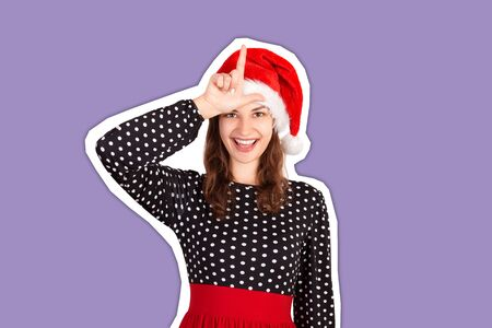 Portrait of playful crazy woman in dress holding hand showing letter L making loser gesture and smiling. Magazine collage style with trendy color background. holiday concept.