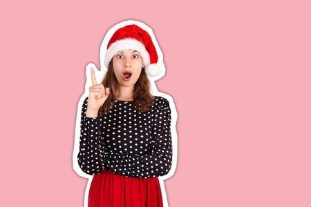 Portrait of woman raising index finger and standing with opened mouth, having suggestion. Magazine collage style with trendy color background. holiday concept.