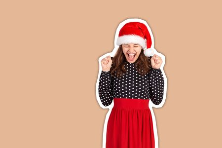 portrait of careless and happy smiling woman in dress. emotional girl in santa claus christmas hat Magazine collage style with trendy color background. Banco de Imagens