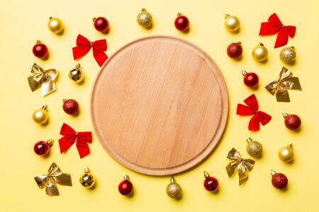 Top view of holiday dinner on colorful background. Plate, baubles and bows. Christmas Eve concept. Stock fotó
