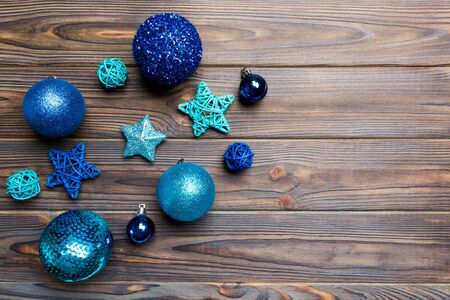 Creative set of New Year baubles and decorations on wooden background. Top view of Christmas time concept. Copy space. Фото со стока