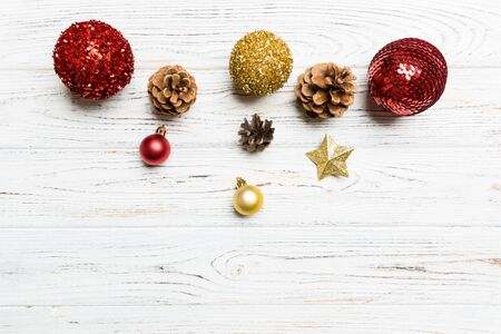 Top view of festive winter composition on wooden background with empty space for your design. Christmas baubles and decorations. New Year concept.